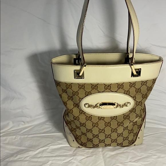 Gucci Handbags - Authentic Gucci cream GG tote purse